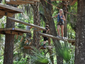 Navigating the Eco-Adventure course at ZOOM AIR ADVENTURE PARK