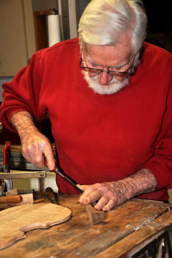 Larry Schorfhaar crafting an insturment in his workshop