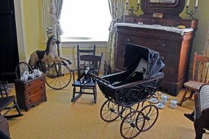 …the children's bedroom where first daughter Mary Virginia Brown's dolls are displayed. Mary's father was Joe Emerson Brown, a Yale Law School graduate and Georgia's 42nd governor.